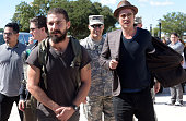 Actors Shia LaBeouf and Brad Pitt attend 'Fury' Fort Benning Georgia Special Screening on October 16 2014 in Columbus Georgia