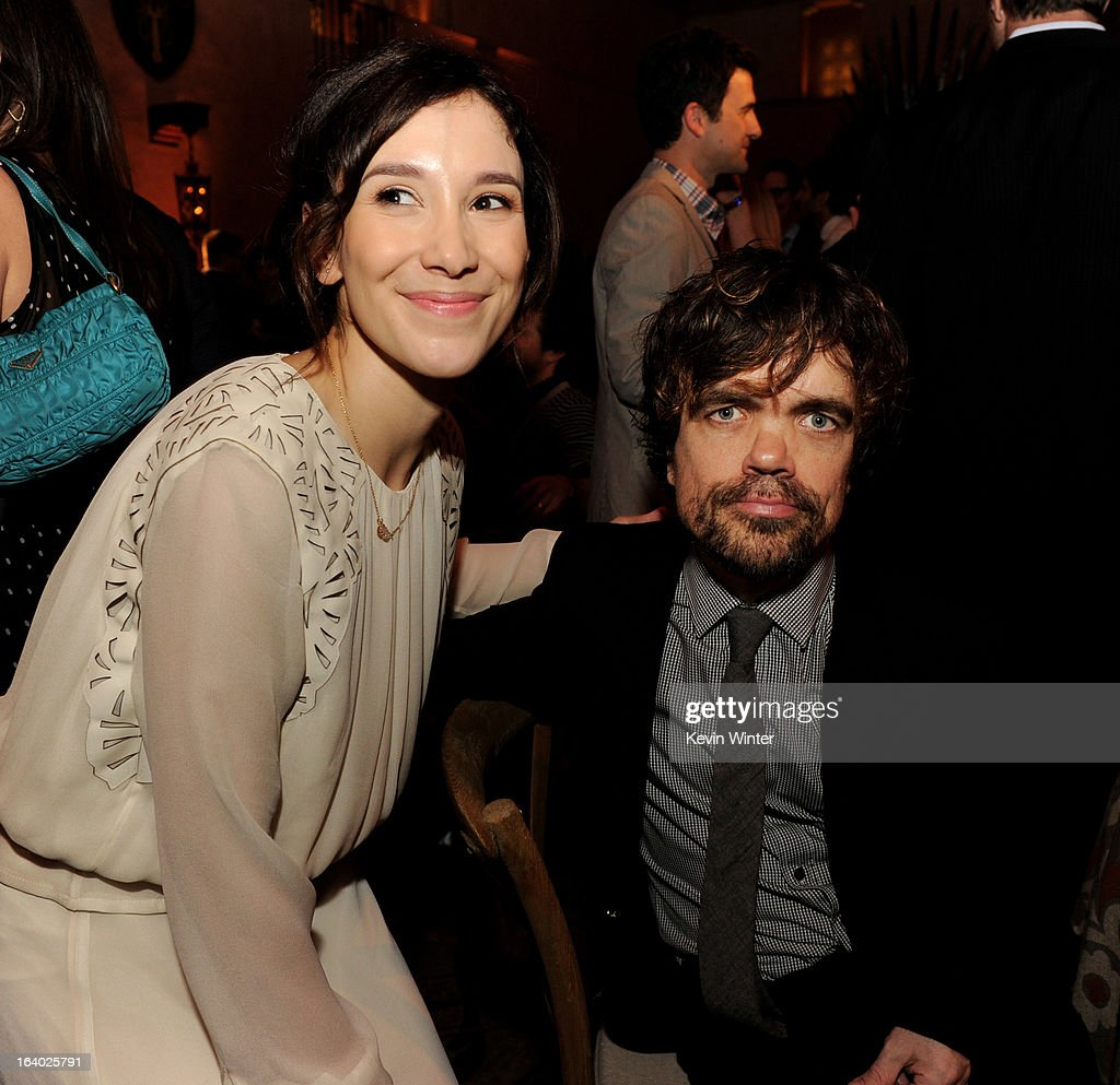 Actors Sibel Kekilli (L) and <a gi-track='captionPersonalityLinkClicked' href=/galleries/search?phrase=Peter+Dinklage&family=editorial&specificpeople=215147 ng-click='$event.stopPropagation()'>Peter Dinklage</a> pose at the after party for the premiere of HBO's 'Game Of Thrones' at the Roosevelt Hotel on March 18, 2013 in Los Angeles, California.