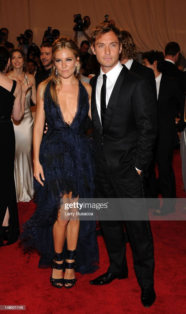 Actors Sienna Miller and Jude Law attend the Costume Institute Gala Benefit to celebrate the opening of the 'American Woman: Fashioning a National Identity' exhibition at The Metropolitan Museum of Art on May 3, 2010 in New York City.