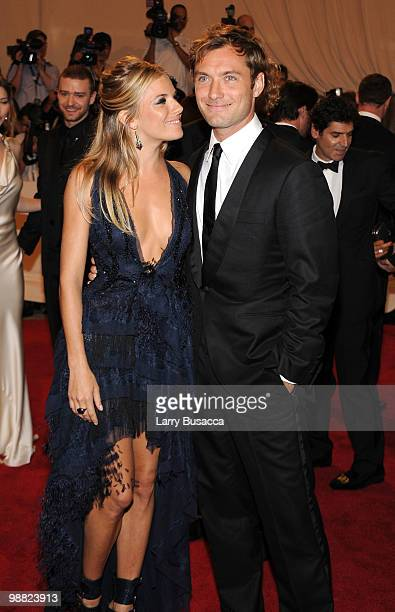 Actors Sienna Miller and Jude Law attend the Costume Institute Gala Benefit to celebrate the opening of the 'American Woman Fashioning a National...