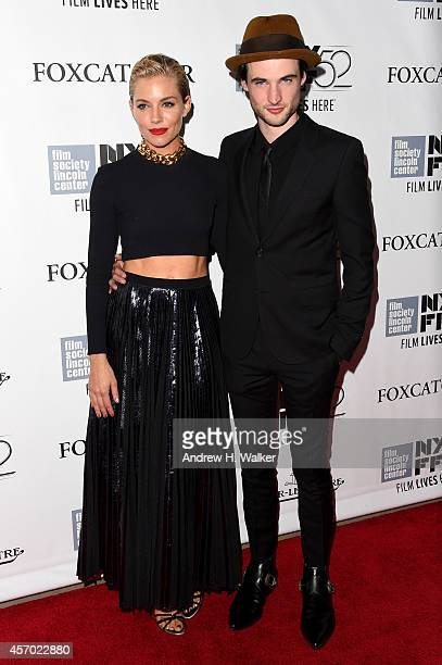Actors Sienna Miller and Tom Sturridge attend the 'Foxcatcher' premiere during the 52nd New York Film Festival at Alice Tully Hall on October 10 2014...