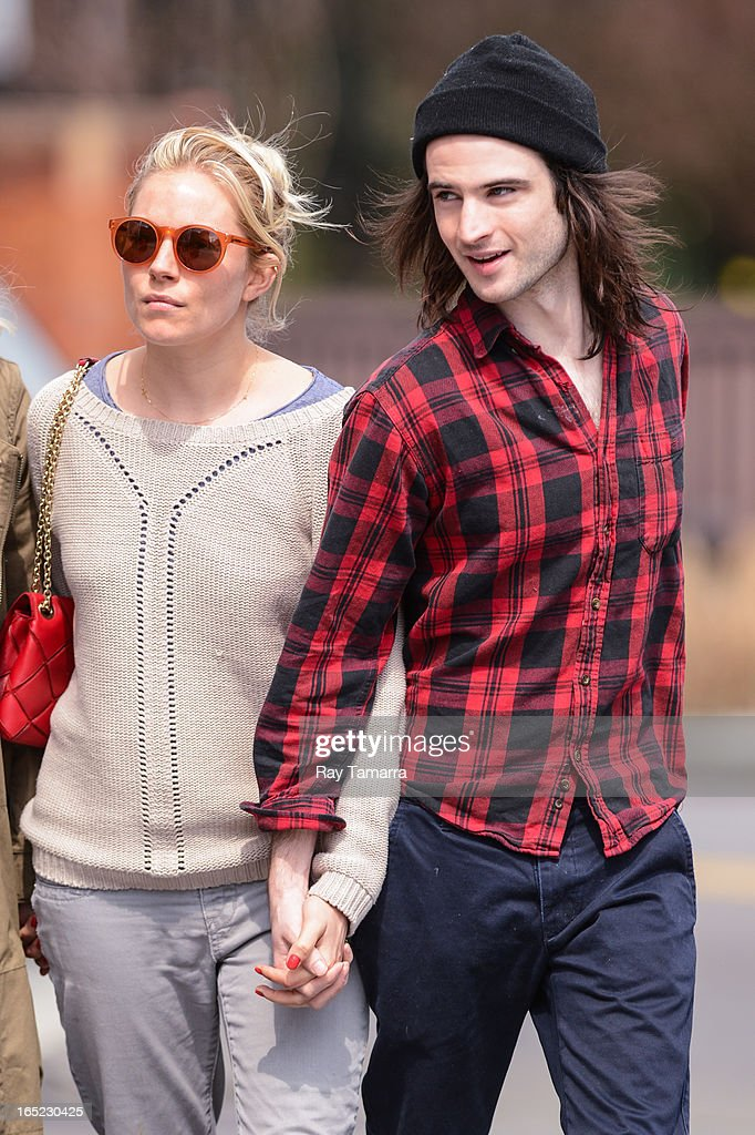 Actors Sienna Miller (L) and Tom Sturridge walk in the West Village on April 1, 2013 in New York City.