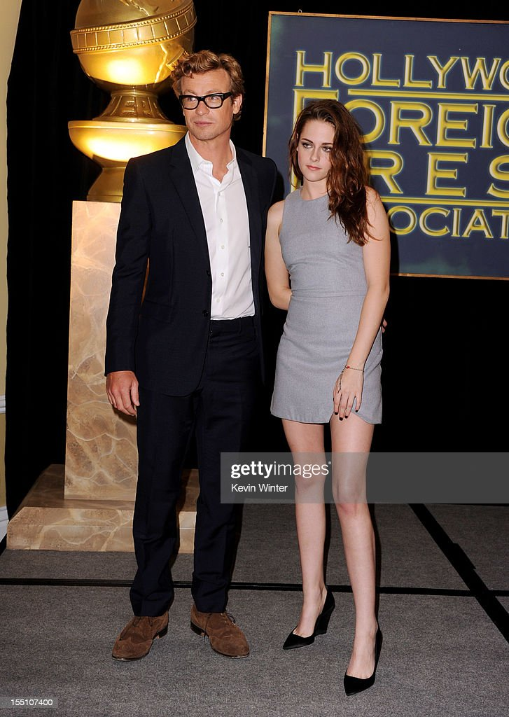 Actors Simon Baker (L) and Kristen Stewart pose at the Hollywood Foreign Press Association's announcement of Jodie Foster as the recipient of the Cecil B. DeMille Award at the Beverly Hills Hotel on November 1, 2012 in Beverly Hills, California.
