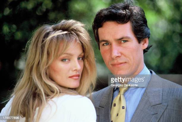 Actors Simon Dutton and Arielle Dombasle pose in a shoot for the TV movie 'The Saint' on August 1989 in London England