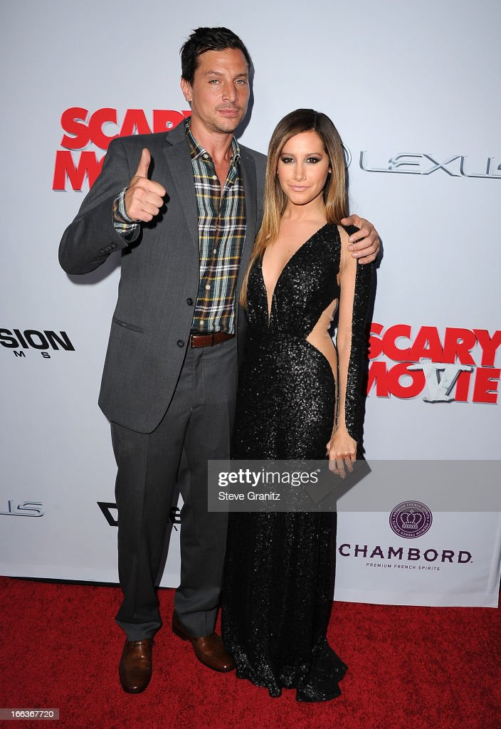 Actors Simon Rex (L) and Ashley Tisdale arrive at the 'Scary Movie V' Los Angeles premiere at ArcLight Cinemas Cinerama Dome on April 11, 2013 in Hollywood, California.