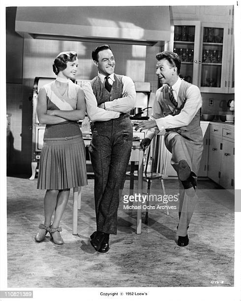 Actors singers and dancers Debbie Reynolds Gene Kelly and Donald O'Connor in a scene from the Loew's/MGM movie 'Singing In The Rain' in 1952 in Los...