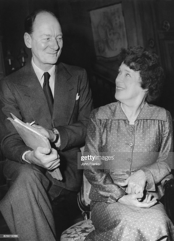 Actors Sir John Gielgud and Kathleen Harrison discuss the script for Noel Coward's new comedy 'Nude With Violin' during rehearsals at the Olympia Theatre in Dublin, Ireland, 13th September 1956. Gielgud is also directing the play.