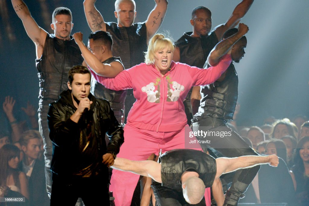 Actors Skylar Astin and Rebel Wilson perform onstage during the 2013 MTV Movie Awards at Sony Pictures Studios on April 14, 2013 in Culver City, California.