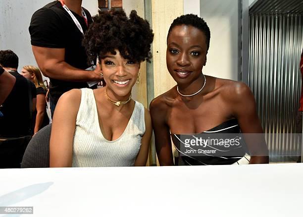 Actors Sonequa MartinGreen and Danai Gurira attend AMC's 'The Walking Dead' at ComicCon 2015 on July 10 2015 in San Diego California