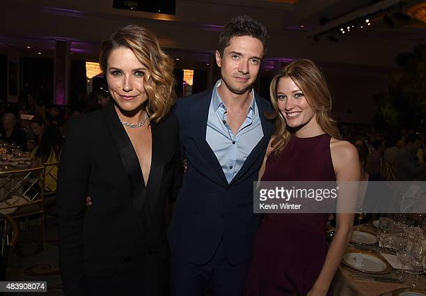 Actors Sophia Bush Topher Grace and Ashley Hinshaw attend HFPA Annual Grants Banquet at the Beverly Wilshire Four Seasons Hotel on August 13 2015 in...