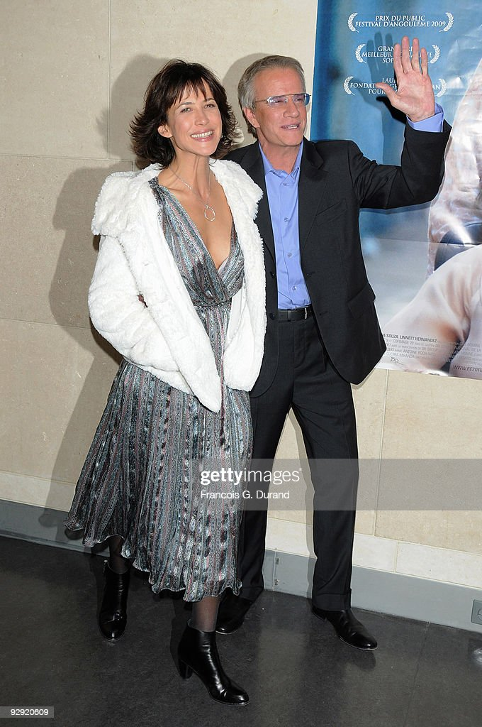 Actors Sophie Marceau and her companion Christopher Lambert attend the premiere of 'L'Homme de chevet' at Cinematheque Francaise on November 9 2009...