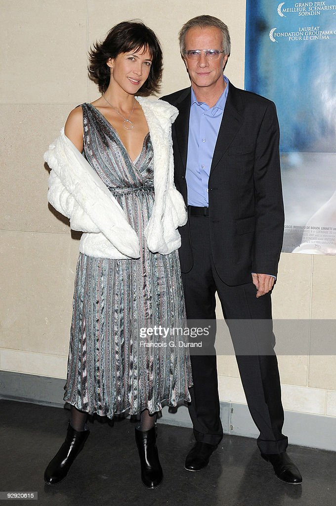 Actors <a gi-track='captionPersonalityLinkClicked' href=/galleries/search?phrase=Sophie+Marceau&family=editorial&specificpeople=220531 ng-click='$event.stopPropagation()'>Sophie Marceau</a> (L) and her companion Christopher Lambert attend the premiere of 'L'Homme de chevet' at Cinematheque Francaise on November 9, 2009 in Paris, France.