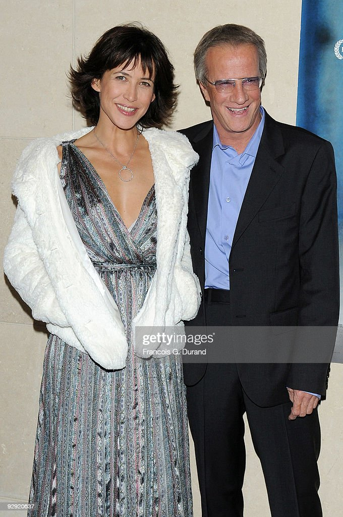 Actors <a gi-track='captionPersonalityLinkClicked' href=/galleries/search?phrase=Sophie+Marceau&family=editorial&specificpeople=220531 ng-click='$event.stopPropagation()'>Sophie Marceau</a> (L) and her companion <a gi-track='captionPersonalityLinkClicked' href=/galleries/search?phrase=Christopher+Lambert&family=editorial&specificpeople=240500 ng-click='$event.stopPropagation()'>Christopher Lambert</a> attend the premiere of 'L'Homme de chevet' at Cinematheque Francaise on November 9, 2009 in Paris, France.
