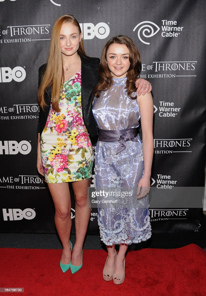 Actors Sophie Turner (L) and Maisie Williams attend 'Game Of Thrones' The Exhibition New York Opening at 3 West 57th Avenue on March 27, 2013 in New York City.