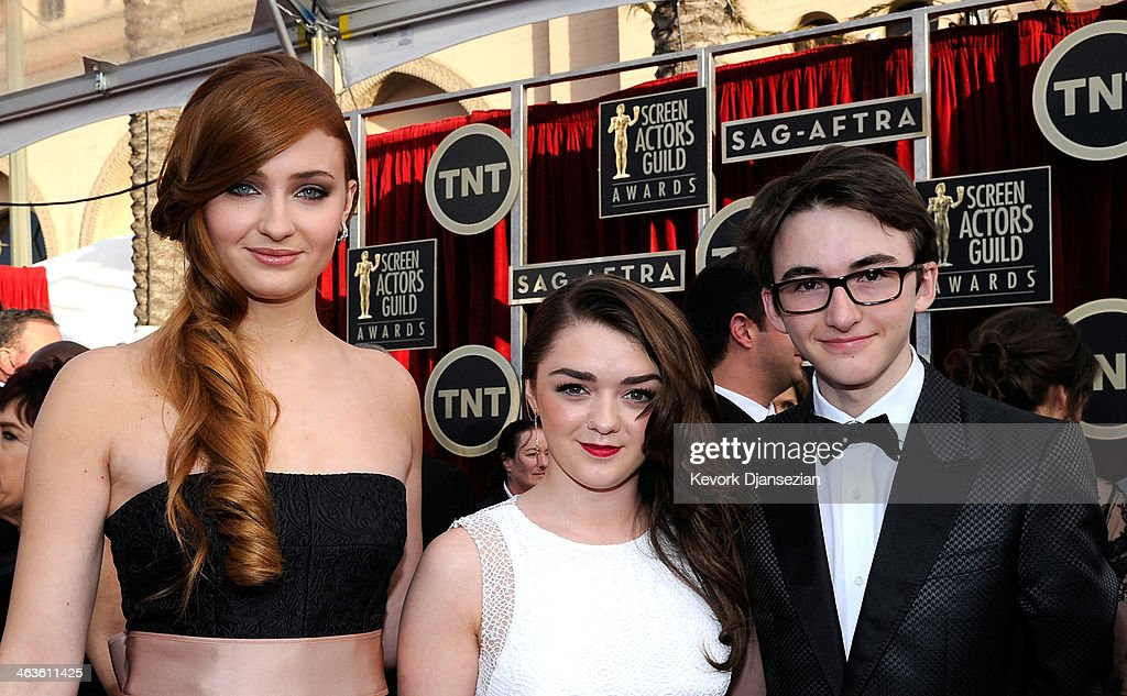 Actors Sophie Turner, Maisie Williams and Isaac Hempstead-Wright, attend the 20th Annual Screen Actors Guild Awards at The Shrine Auditorium on January 18, 2014 in Los Angeles, California.