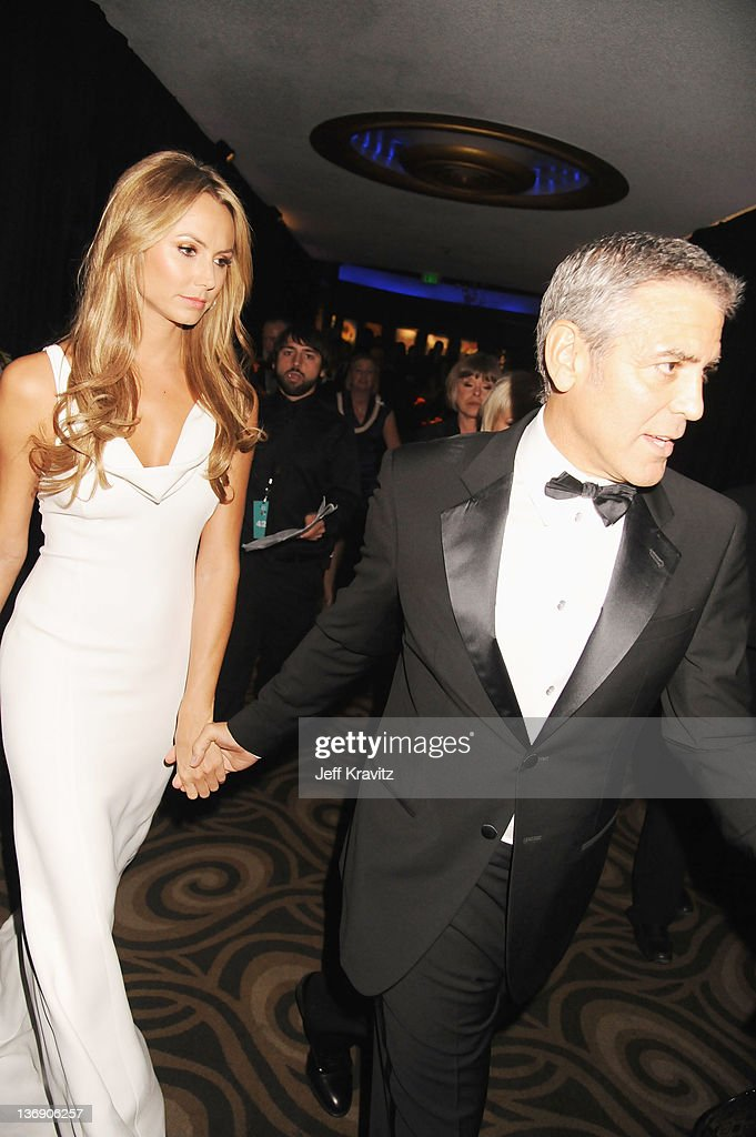 Actors Stacy Keibler and George Clooney attend the 17th Annual Critics' Choice Movie Awards held at The Hollywood Palladium on January 12, 2012 in Los Angeles, California.