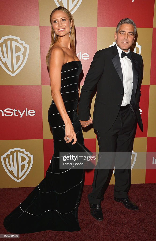 Actors Stacy Keibler and George Clooney attend the 2013 InStyle and Warner Bros. 70th Annual Golden Globe Awards Post-Party held at the Oasis Courtyard in The Beverly Hilton Hotel on January 13, 2013 in Beverly Hills, California.