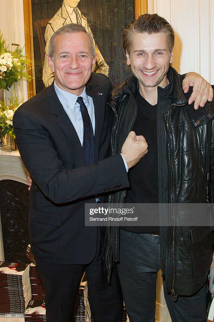 Actors Stanislas Merhar (R) and Francis Huster attend the signing of Huster's book 'And Dior Created Woman' at Dior Boutique on November 19, 2012 in Paris, France.