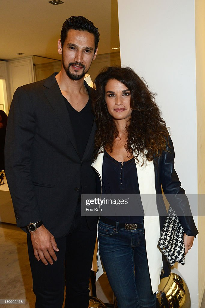 Actors Stany Coppet and Barbara Cabrita attend the Christian Dior Shop Cocktail during the Vogue Fashion Night Out on Rue Saint Honore on September 17, 2013 in Paris, France.