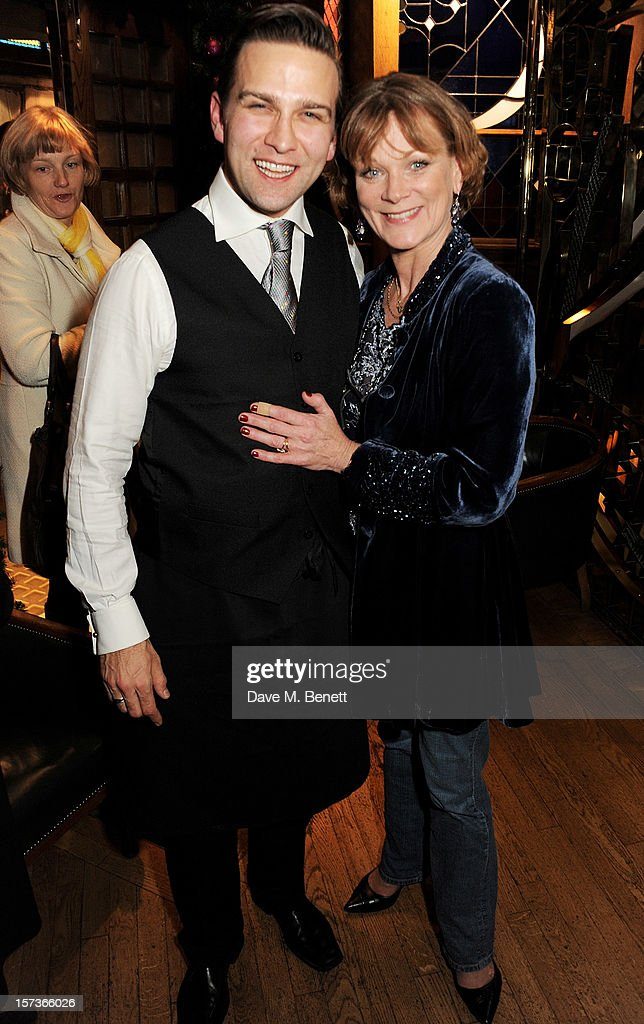 Actors Stefan Booth (L), working as a watier, and Samantha Bond, working as a hostess, attend One Night Only at The Ivy, featuring 30 stage and screen actors working as staff during dinner at The Ivy, in aid of The Combined Theatrical Charities, on December 2, 2012 in London, England.