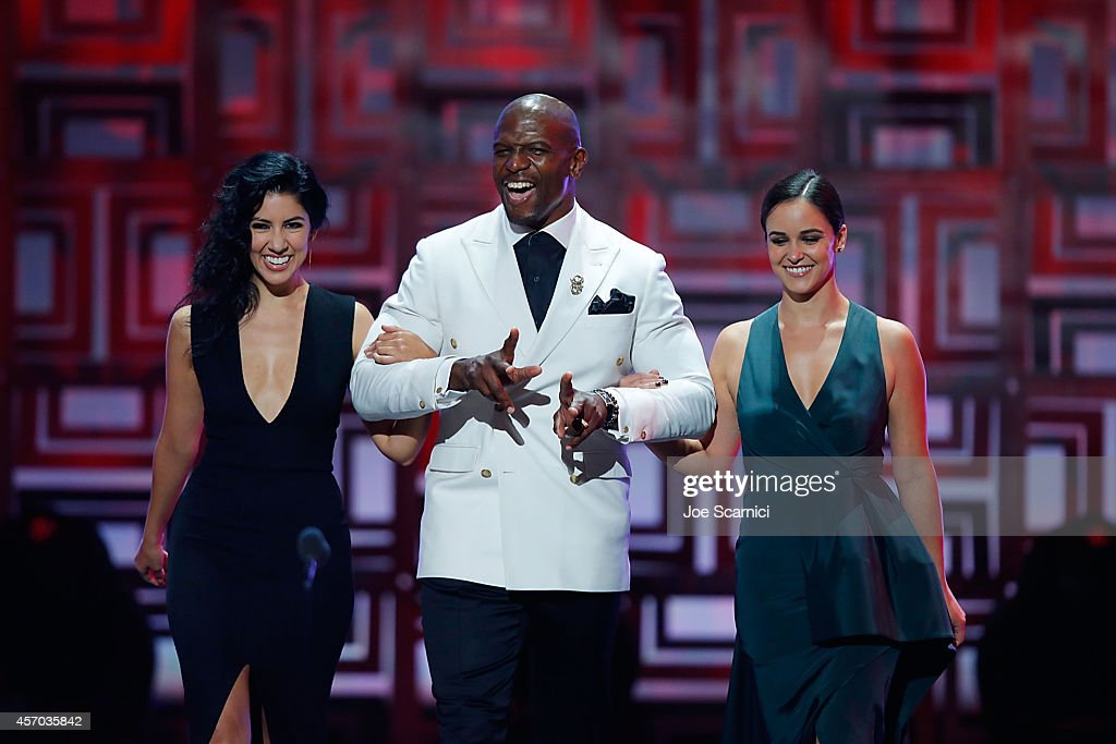 Actors Stephanie Beatriz Terry Crews and Melissa Fumero speak onstage during the 2014 NCLR ALMA Awards at Pasadena Civic Auditorium on October 10...