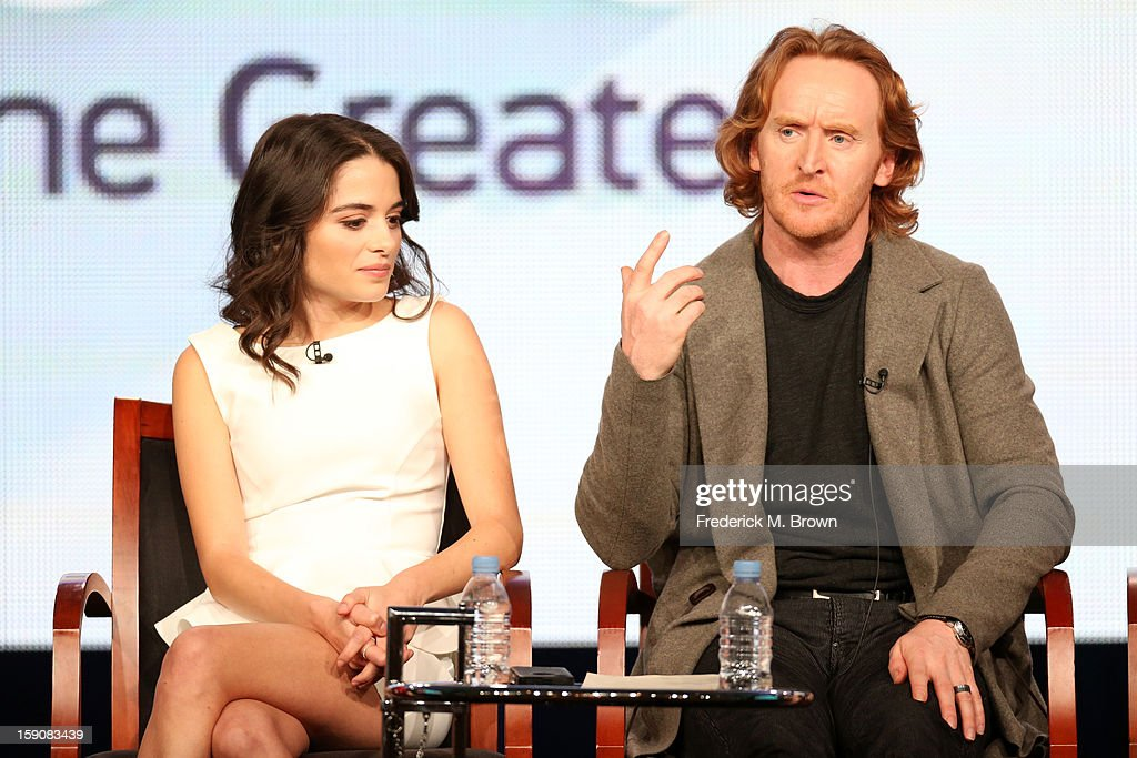 Actors Stephanie Leonidas (L) and Tony Curran speak onstage at the 'Defiance' panel discussion during the Syfy portion of the 2013 Winter TCA Tour- Day 4 at the Langham Hotel on January 7, 2013 in Pasadena, California.