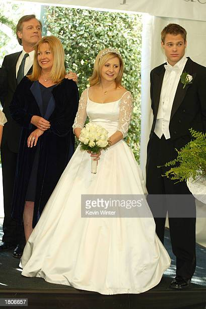 Actors Stephen Collins Catherine Hicks Beverley Mitchell and George Stults pose at a reception to celebrate 150 episodes of The WB's '7th Heaven' on...