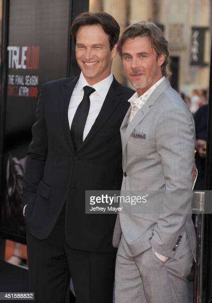 Actors Stephen Moyer and Sam Trammell arrive at HBO's 'True Blood' final season premiere at TCL Chinese Theatre on June 17 2014 in Hollywood...