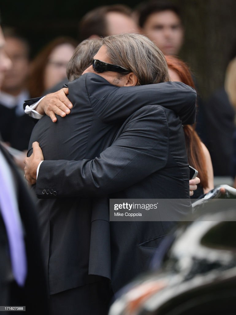 Actors Steve Buscemi (L) and Michael Imperioli embrace at the funeral for actor James Gandolfini at The Cathedral Church of St. John the Divine on June 27, 2013 in New York City. Gandolfini passed away on June 19, 2013 while vacationing in Rome, Italy.