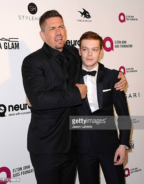 Actors Steve Howey and Cameron Monaghan attend the 24th annual Elton John AIDS Foundation's Oscar viewing party on February 28 2016 in West Hollywood...