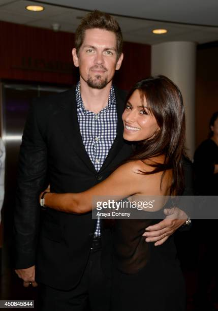 Actors Steve Howey and Sarah Shahi attend the premiere of 'The Road Within' during the 2014 Los Angeles Film Festival at Regal Cinemas LA Live on...