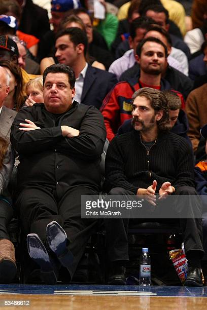 Actors Steven R Schirripa and Michael Imperioli formerly with the HBO series 'The Sopranos' watch the New York Knicks and the Miami Heat play at...