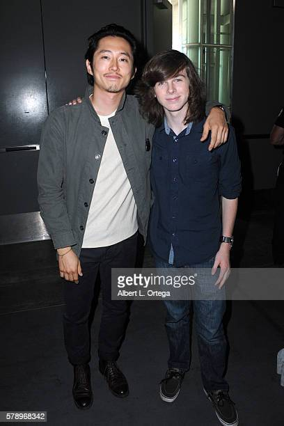 Actors Steven Yeun and Chandler Riggs attend AMC's 'The Walking Dead' panel during ComicCon International 2016 at San Diego Convention Center on July...