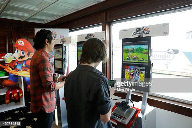 Actors Steven Yeun and Chandler Riggs attend the Nintendo Lounge On The TV Guide Magazine Yacht At ComicCon #TVGMYacht during San Diego ComicCon...