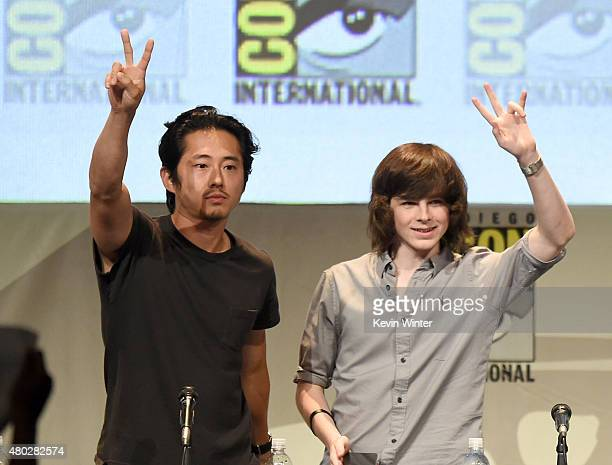 Actors Steven Yeun and Chandler Riggs speak onstage at AMC's 'The Walking Dead' panel during ComicCon International 2015 at the San Diego Convention...