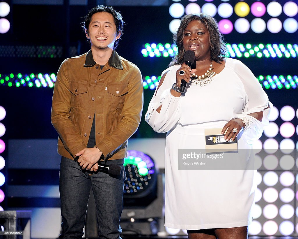 Actors <a gi-track='captionPersonalityLinkClicked' href=/galleries/search?phrase=Steven+Yeun&family=editorial&specificpeople=7249223 ng-click='$event.stopPropagation()'>Steven Yeun</a> (L) and Retta speak onstage at the MTVu Fandom Awards during Comic-Con International 2014 at PETCO Park on July 24, 2014 in San Diego, California.