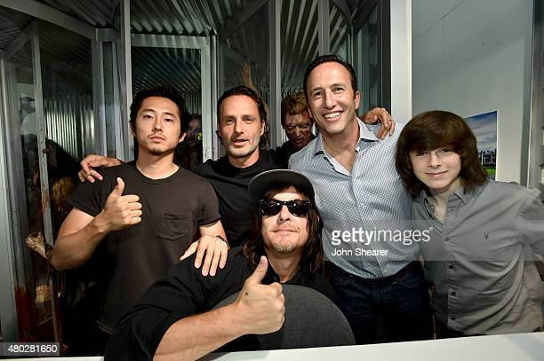 Actors Steven Yeun Andrew Lincoln Norman Reedus AMC President General Manager Charlie Collier and actor Chandler Riggs attend AMC's 'The Walking...