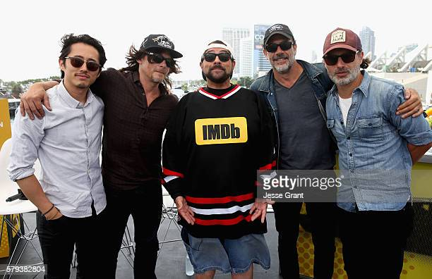 Actors Steven Yeun Norman Reedus director Kevin Smith Jeffrey Dean Morgan Andrew Lincoln attend AMC at ComicCon on July 23 2016 in San Diego...