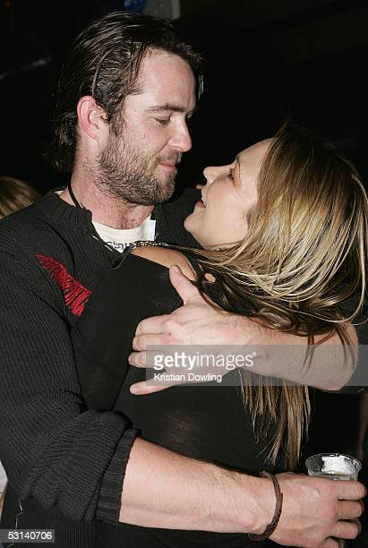 Actors Sullivan Stapleton and Carla Bonner at the Neighbours Rocks for AIDS Fundraiser June 23 2005 at the Palace in Melbourne Australia