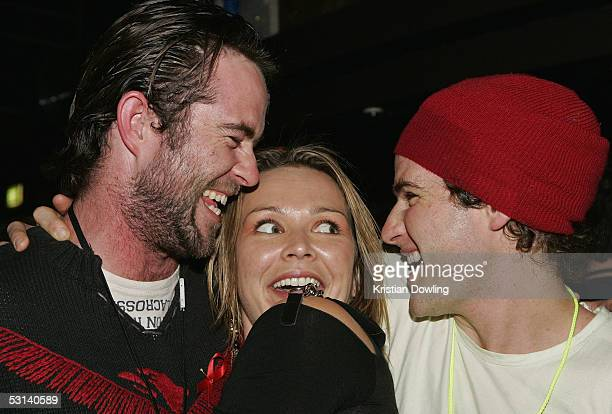 Actors Sullivan Stapleton Carla Bonner and Bernard Curry at the Neighbours Rocks for AIDS Fundraiser June 23 2005 at the Palace in Melbourne Australia