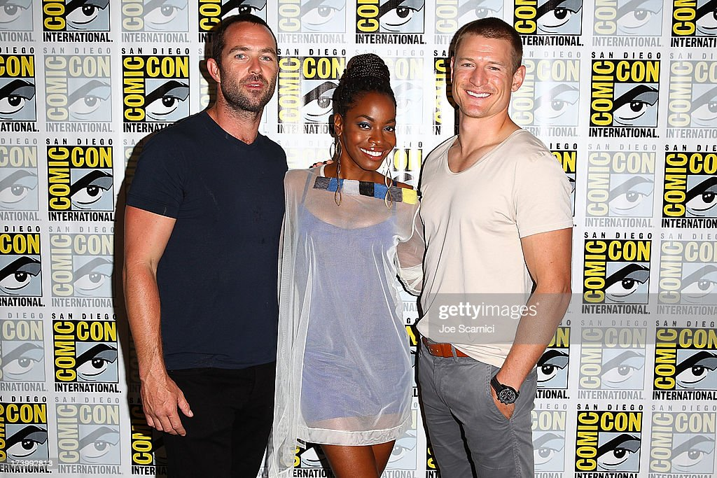Actors Sullivan Stapleton, Milauna Jackson and Phillip Winchester attend the Strike back press line at Comic-Con International 2013 - Day 1 on July 18, 2013 in San Diego, California.
