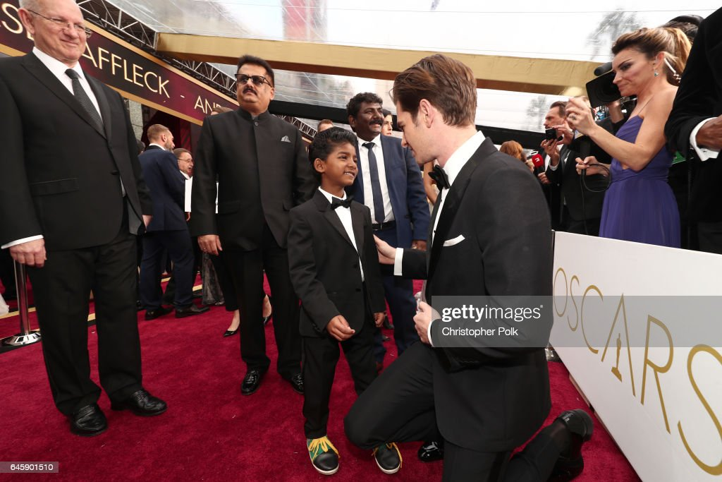 Actors Sunny Pawar (L) and Andrew Garfield attend the 89th Annual Academy Awards at Hollywood & Highland Center on February 26, 2017 in Hollywood, California.