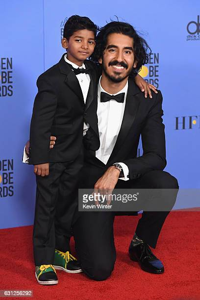 Actors Sunny Pawar and Dev Patel pose in the press room during the 74th Annual Golden Globe Awards at The Beverly Hilton Hotel on January 8 2017 in...