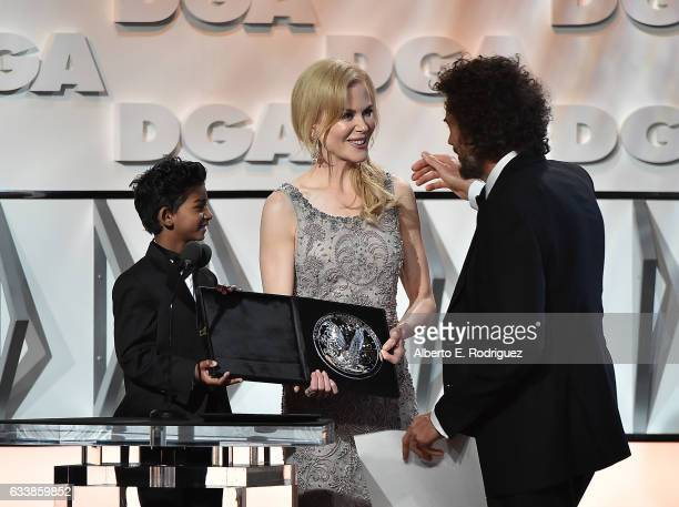 "Actors Sunny Pawar and Nicole Kidman present the Feature Film Nomination Plaque for ""Lion"" to director Garth Davis onstage during the 69th Annual..."