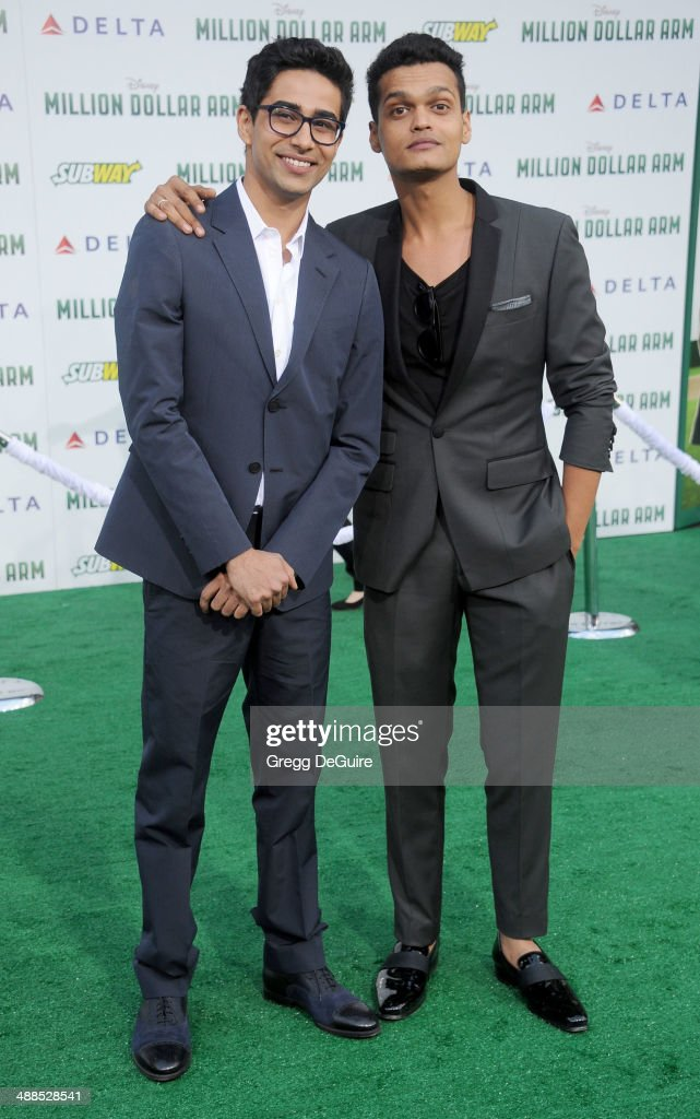 Actors Suraj Sharma and Madhur Mittal arrive at the Los Angeles premiere of 'Million Dollar Arm' at the El Capitan Theatre on May 6, 2014 in Hollywood, California.