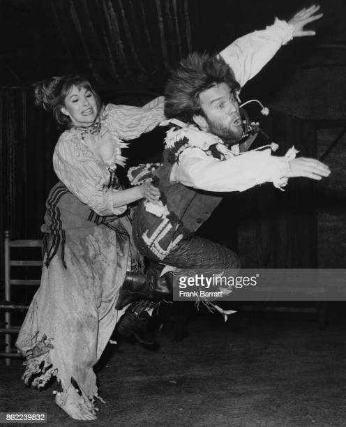 Actors Susan Hampshire as Katherina and Nicky Henson as Petruchio rehearsing a fight scene for the Shakespeare play 'The Taming of the Shrew' at the...