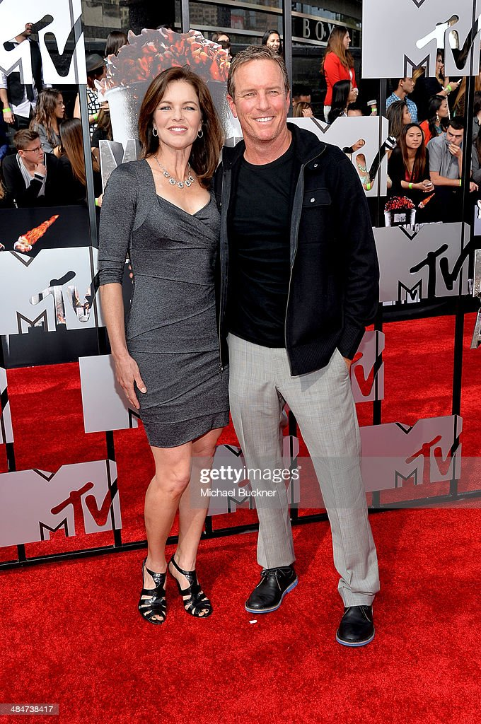 Actors Susan Walters (L) and Linden Ashby attend the 2014 MTV Movie Awards at Nokia Theatre L.A. Live on April 13, 2014 in Los Angeles, California.