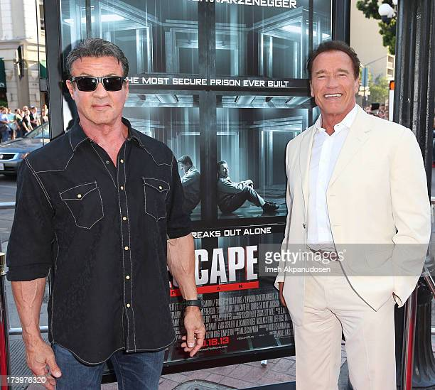 Actors Sylvester Stallone and Arnold Schwarzenegger attend the 'Escape Plan' premiere during ComicCon International 2013 at Reading Cinemas Gaslamp...