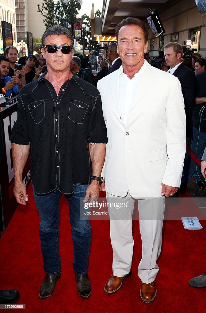 Actors Sylvester Stallone (L) and Arnold Schwarzenegger attend the 'Escape Plan' screening and red carpet during Comic-Con International 2013 at Reading Cinemas Gaslamp on July 18, 2013 in San Diego, California.