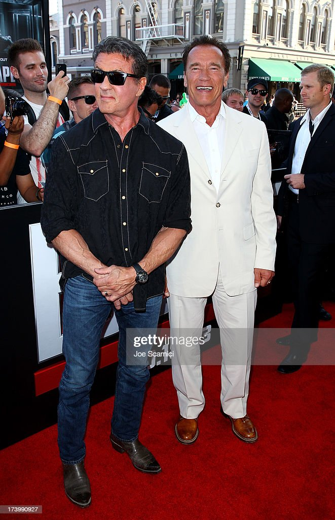 Actors Sylvester Stallone and Arnold Schwarzenegger attend the 'Escape Plan' screening and red carpet during Comic-Con International 2013 at Reading Cinemas Gaslamp on July 18, 2013 in San Diego, California.